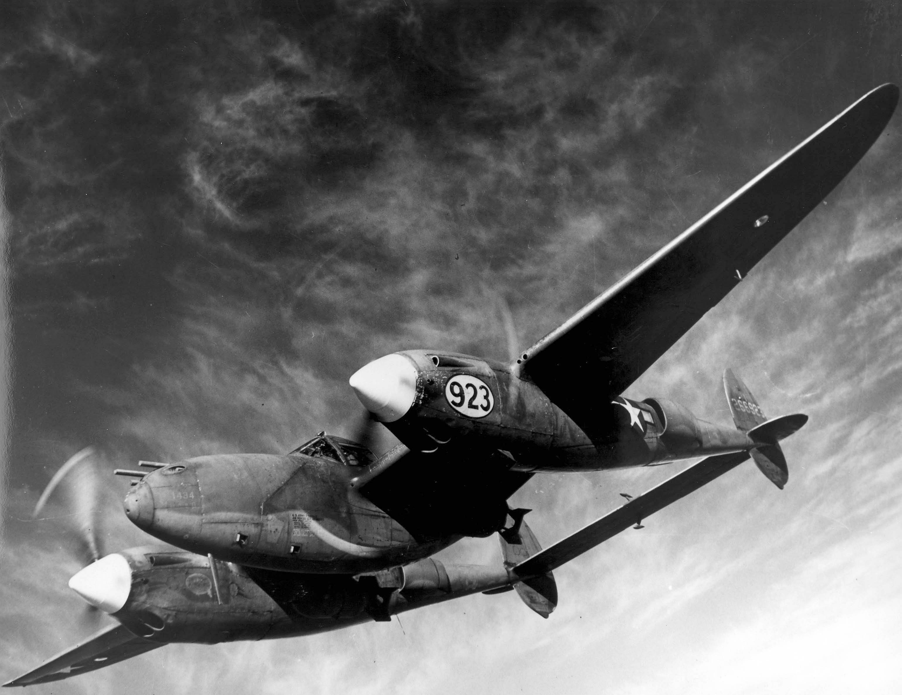 Orlando, Fla. - Barely visible beneath the wings of a Lockhead P-38 Lighting are the deadly bombs with which this multi-purpose plane can blast enemy troops, ships and gun emplacements.  As shown in recent demonstartions at the AAF Tactical Center, Orlando, Fla., the Lockhead P-38, now being used as a fighter-bomber, is capable of carrying bomb pay loads up to 2,000 pounds, thus affording the Allies another potent weapon for use against Germany and Japan in coming offensive.