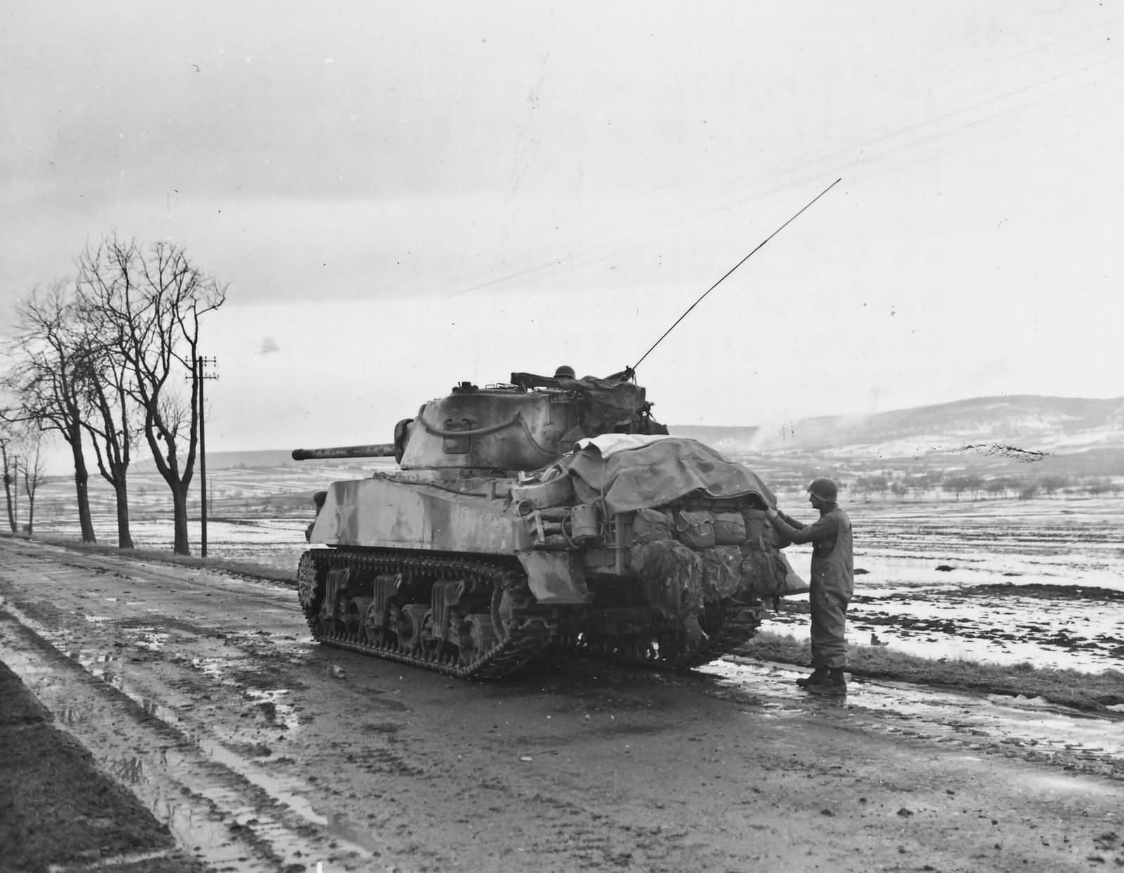 12th_Armored_Division_76mm_Armed_M4_Sherman_Husseren_France_1945 (1)
