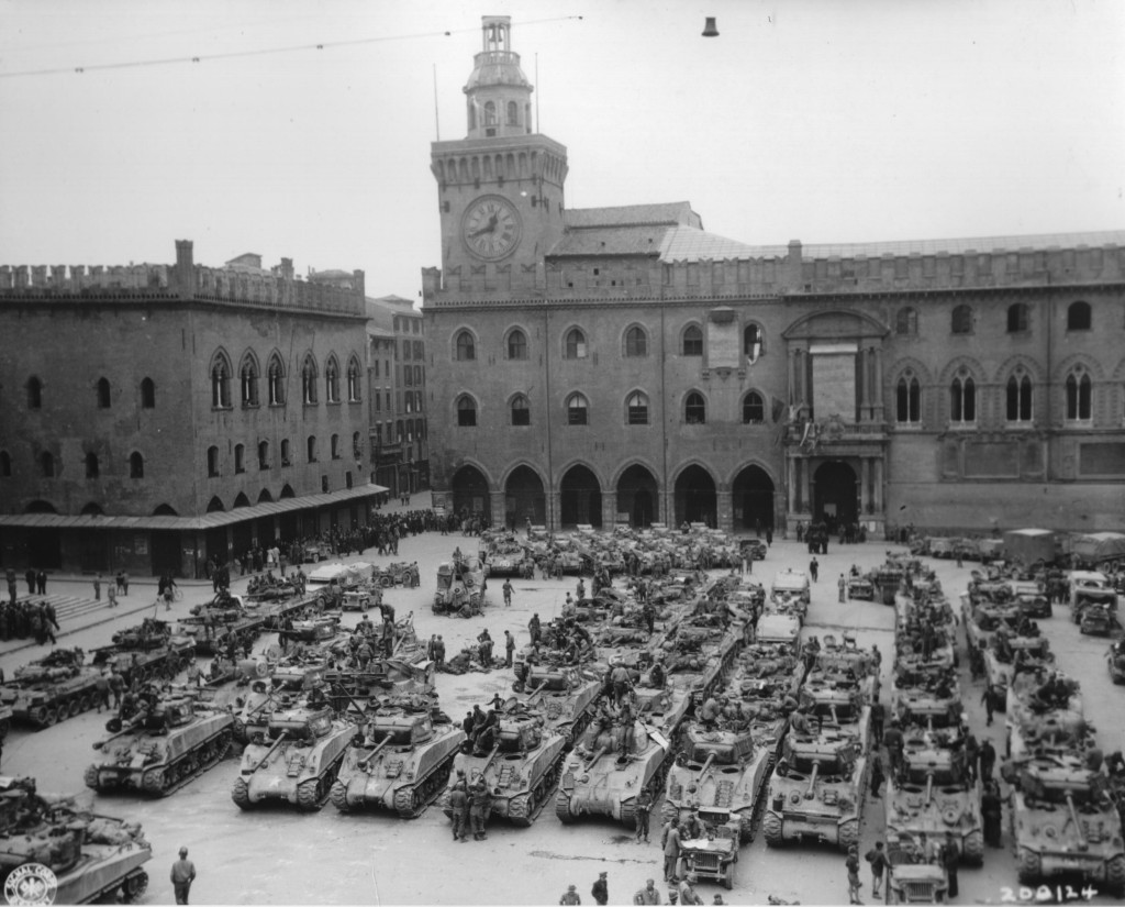A whole tank company or more parked in a square.