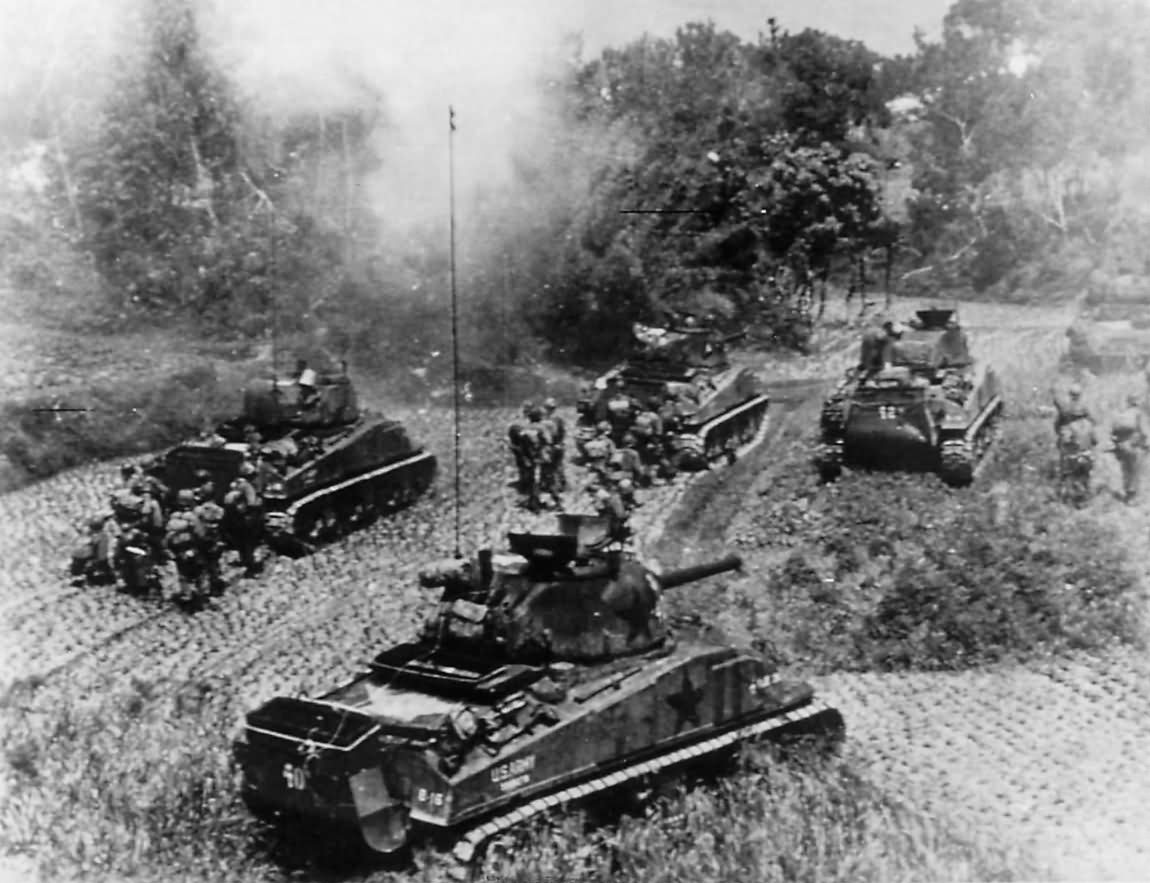 Troops_and_M4_Sherman_tanks_of_10th_Army_advancing_on_Okinawa