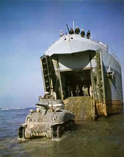 LST delivery an M4A1 to the beach, probably a 1st Armored Division tank to North Africa