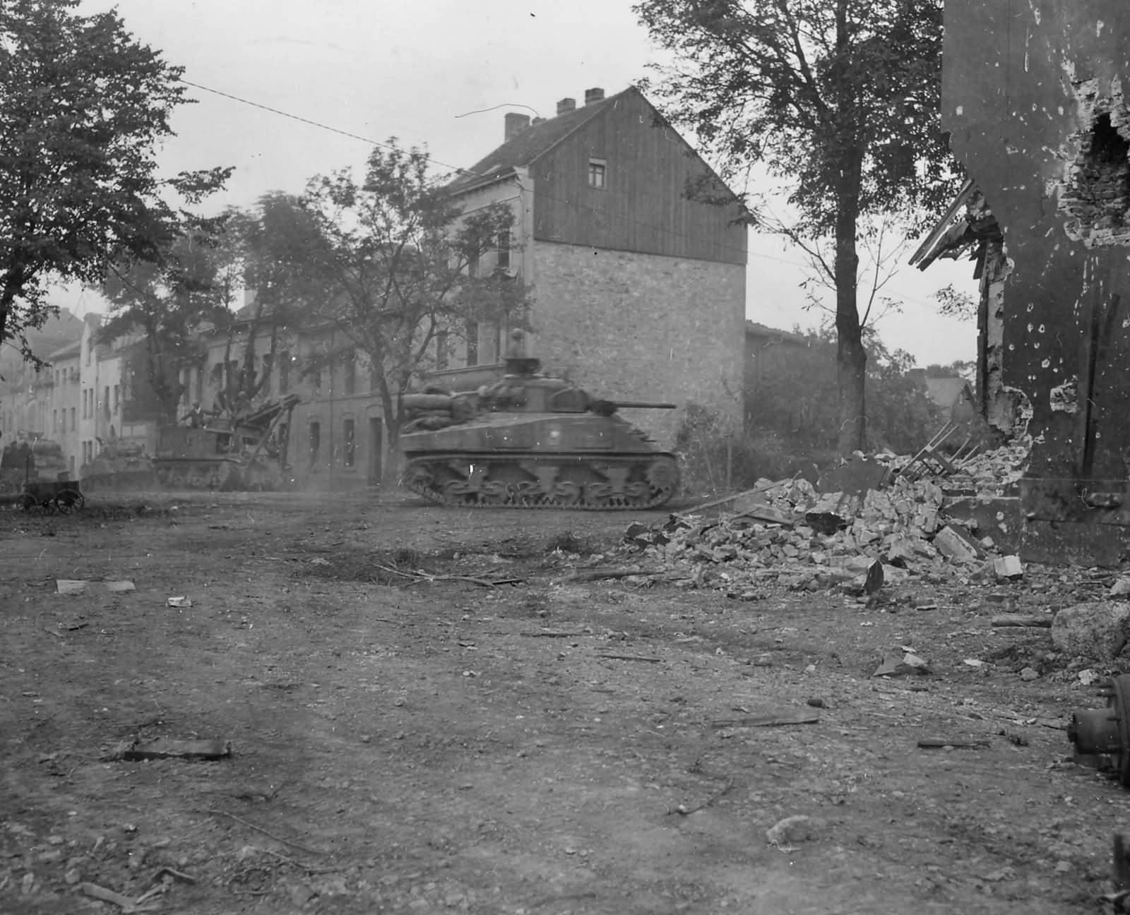 3rd_Armored_Division_M4_Sherman_and_T2_Grant_Recovery_Vehicle_Stolberg_Germany_1945