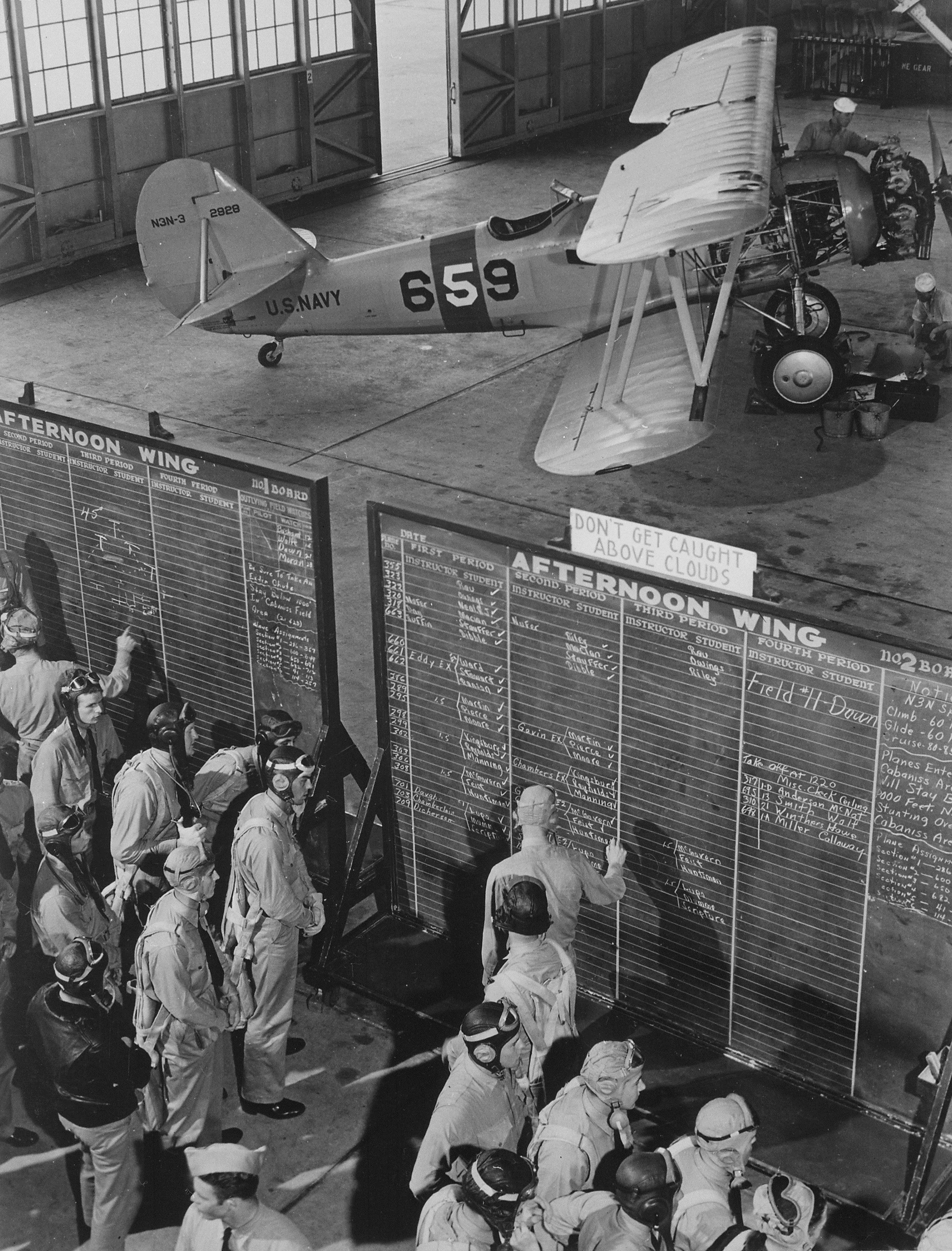 Aviation_cadets_check_flight_boards_for_last_minute_instructions_at_Naval_Air_Training_Center_Corpus_Christi_Texas...._-_NARA_-_520975