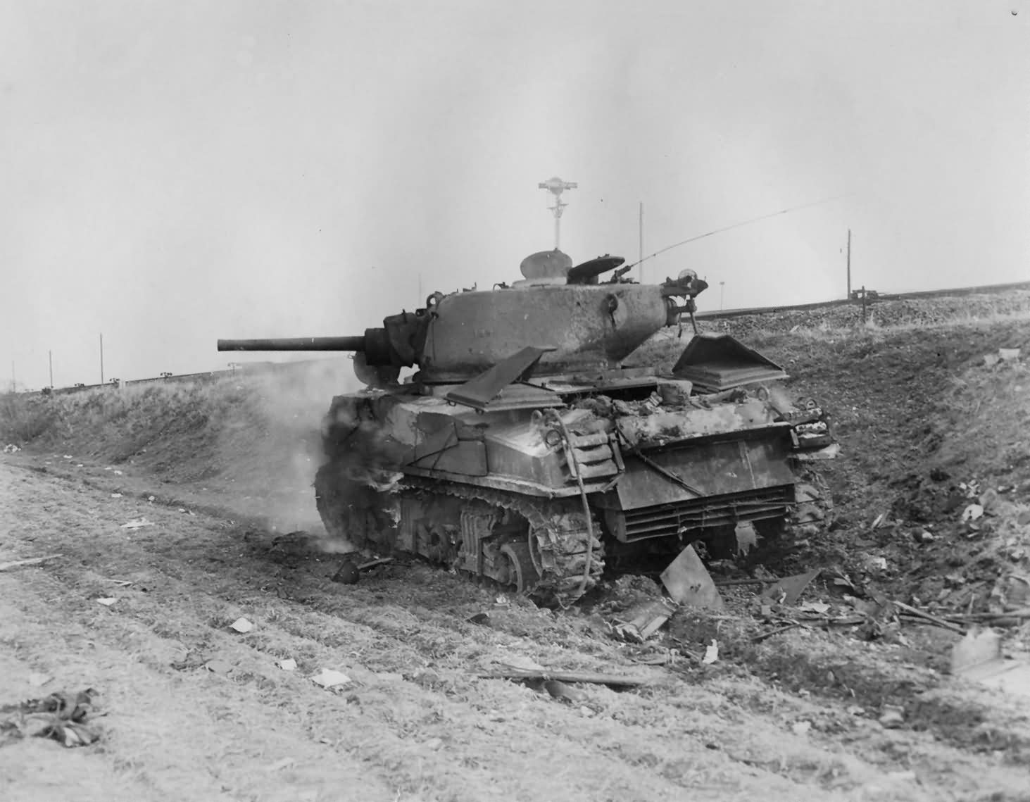 Burning_JUMBO_Sherman_Tank_1st_Armored_Division_February_1945