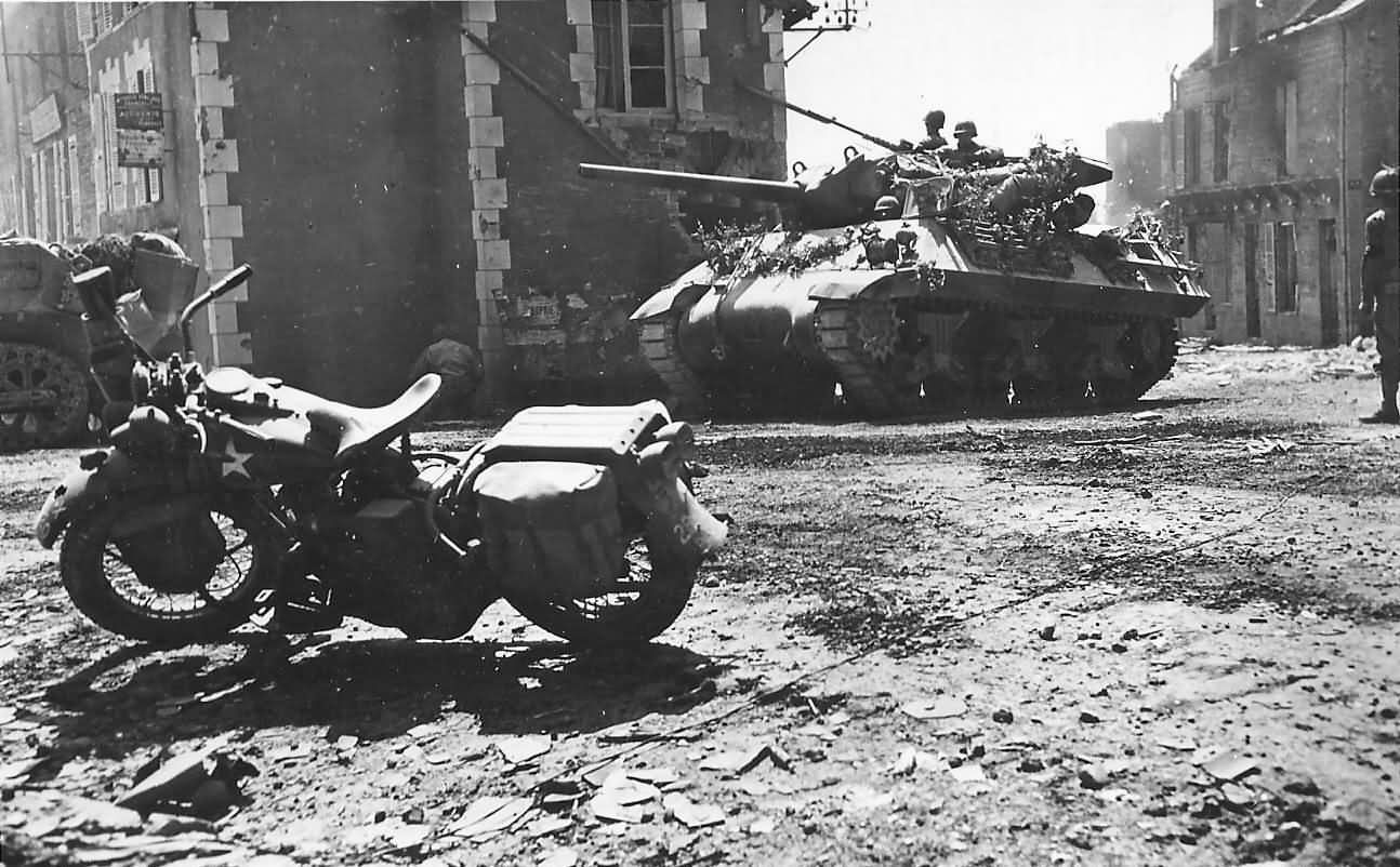 Camouflaged_M10_Tank_Destroyer_And_Harley_Davidson_In_Percy_France_08_1944