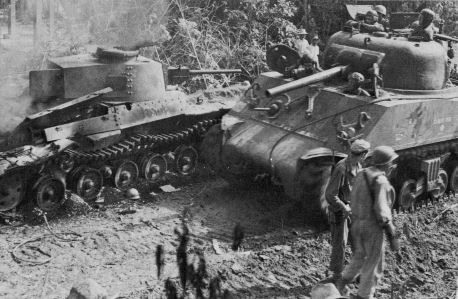 Classy-Peg-passing-destroyed-Japanese-Shinhoto-Chiha-tank-on-Luzon-in-the-Phillipines-17-Jan-1945