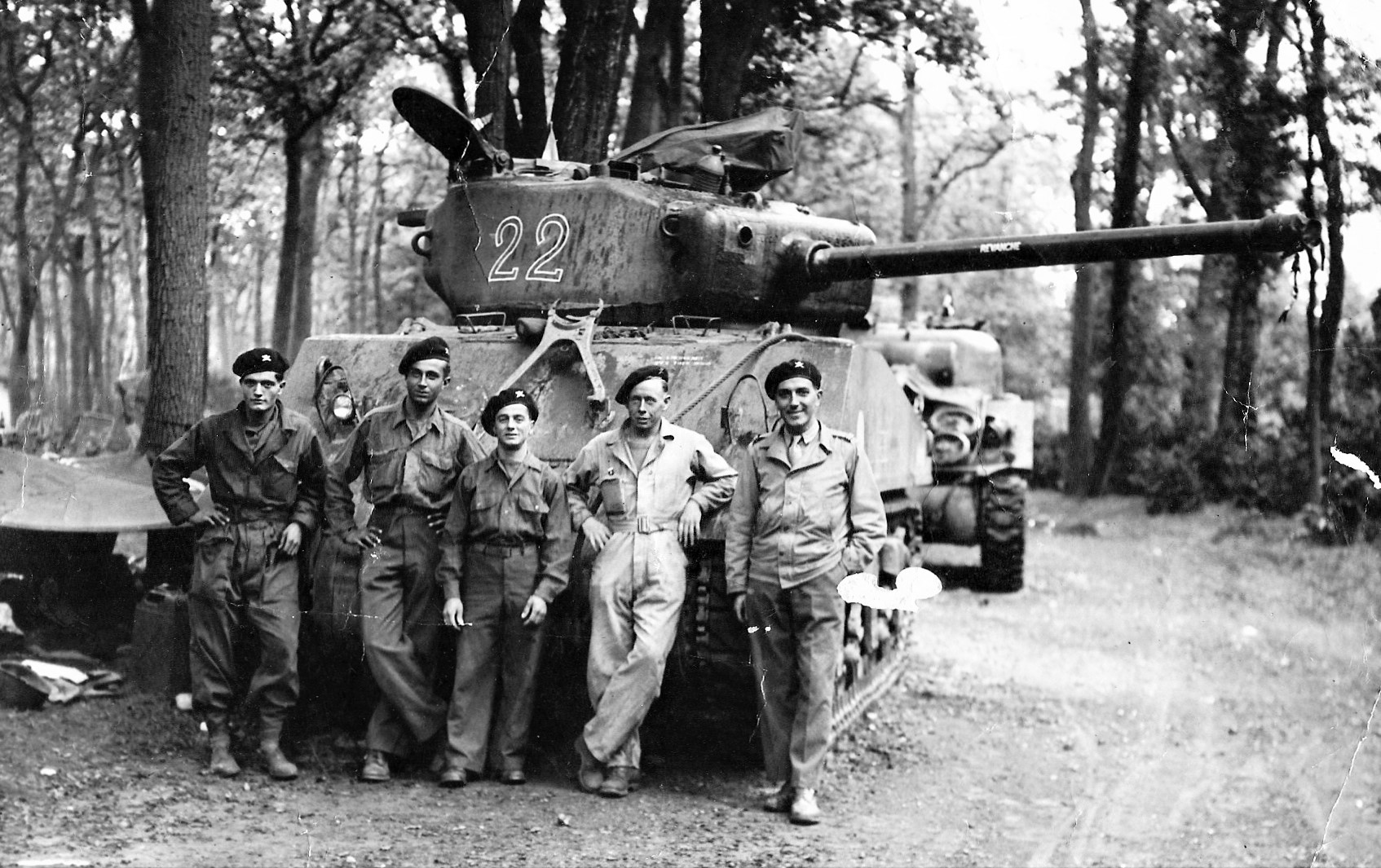 French crew on the background of the tank Sherman M4A2 (76) W of the 2nd company of the 501st Tank Regiment (2 Compagnie de Chars, 501 RCC)