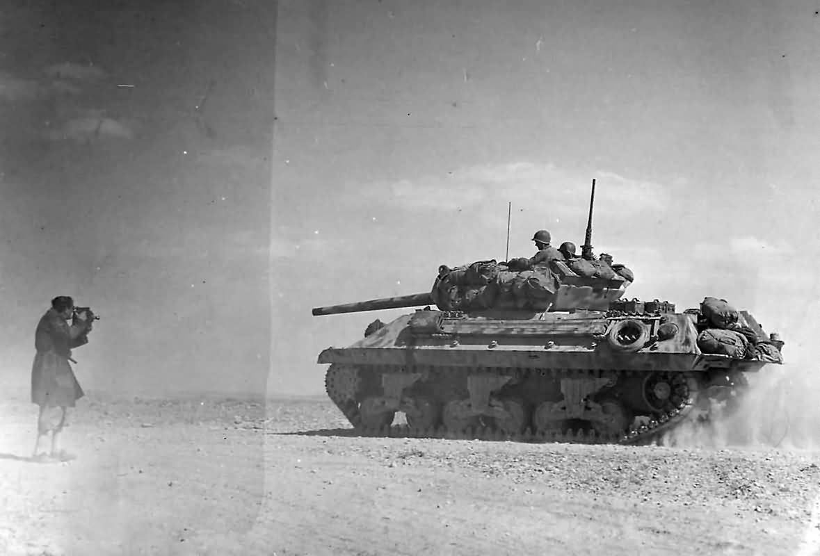 M10_Tank_Destroyer_Heads_To_Battle_Lines_At_Bir_Marbott_Pass_East_Of_El_Guettar_In_Tunisia_1943.