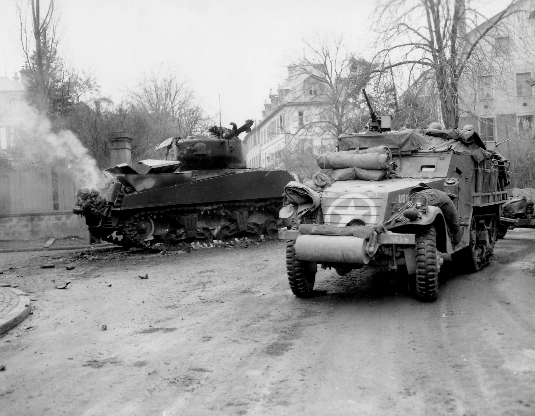 M3A1_Halftrack_burnedout_M4Sherman_1945_Warning_Tank Commander dead in turret