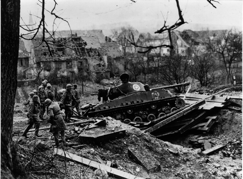 M4A3E8-tank-on-bridge-that-collapsed-with-weight-of-vehicle-during-operation-against-Glossbliederstroff-on-the-Saar-Tank-is-from-the-749th-Tank-Battalion-18-Februay-19