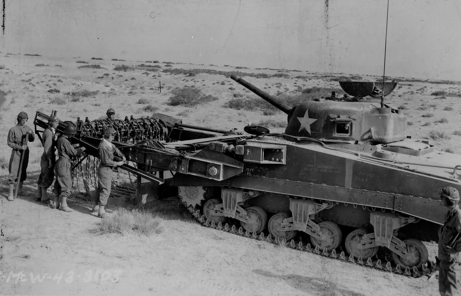 M4_Sherman_Flail_Scorpion_Mine_Clearing_Track_Undergoes_Testing_North_Africa_1943 (1)