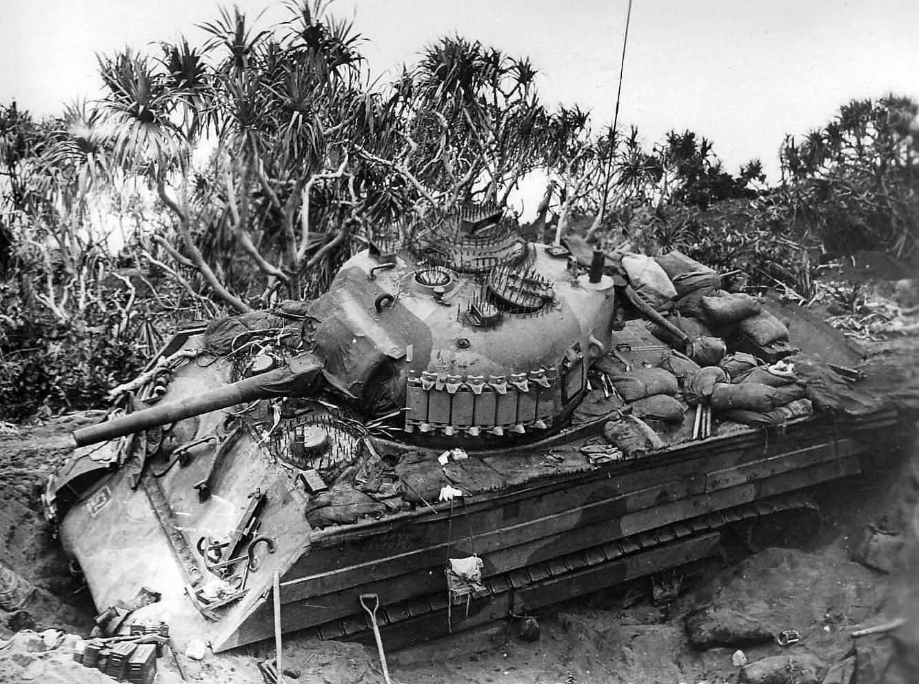 marine_m4a3_sherman_of_the_5th_tank_battalion_in_ditch_iwo_jima