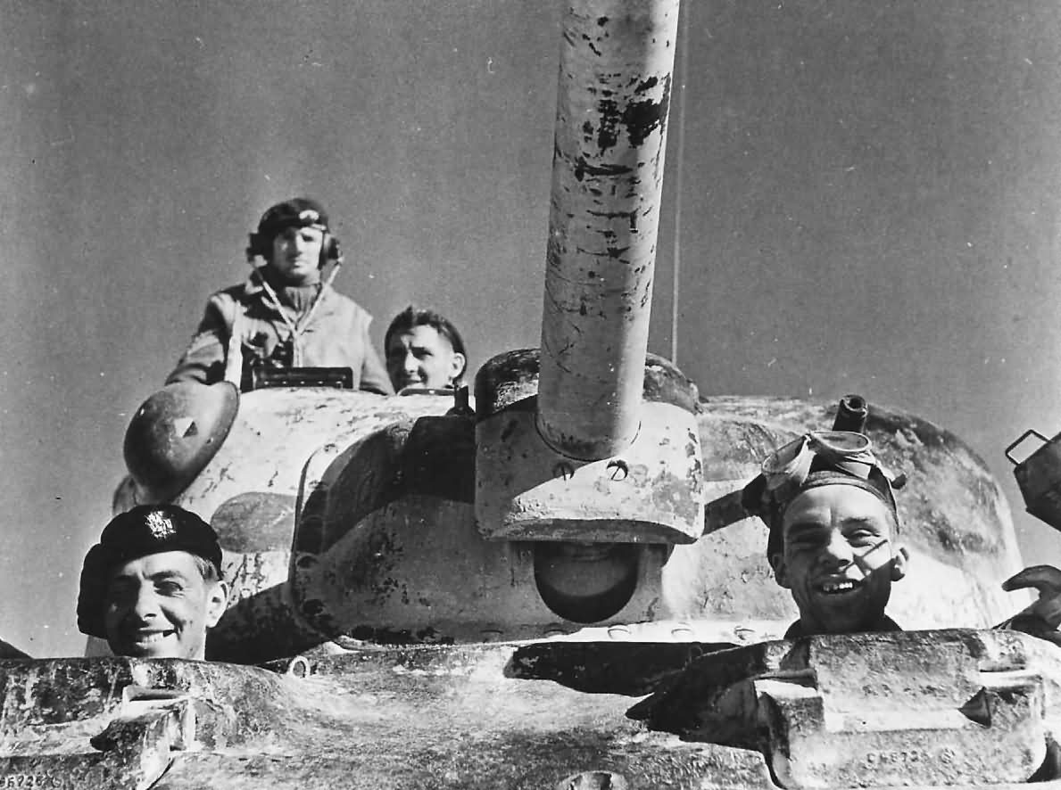 Smiling_British_Soldiers_in_M4_Sherman_Tank_1943